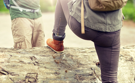 close up of couple with backpacks hiking Stock Photo