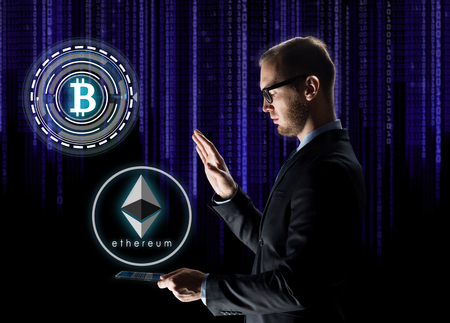 business, cryptocurrency and future technology concept - businessman with transparent tablet pc computer and virtual bitcoin and ethereum holograms over ultra violet binary code on black background