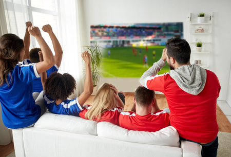 friends or football fans watching soccer