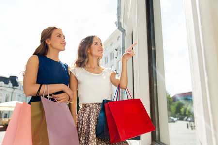 happy women with shopping bags at storefront Stockfoto - 101264695
