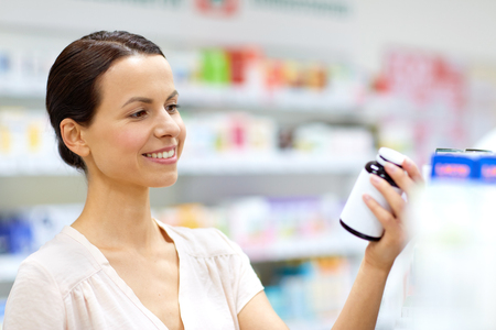 female customer choosing drugs at pharmacy