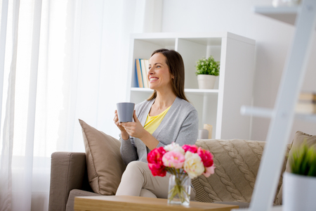 happy woman drinking tea or coffee at home Stock fotó