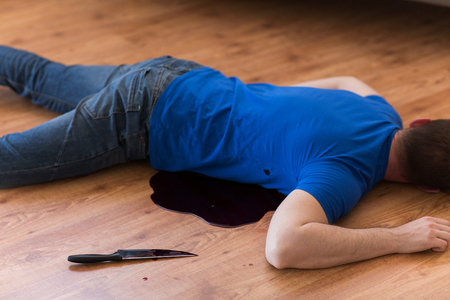 dead man body lying on floor at crime scene