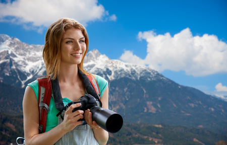 woman with backpack and camera over alps mountains 写真素材
