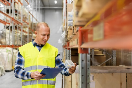 warehouse worker with clipboard and plastic box