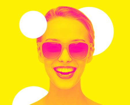 happy amazed teenage girl in sunglasses
