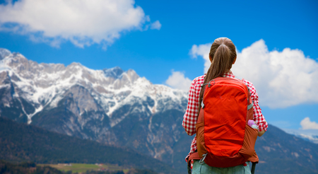 woman with backpack over alps mountains