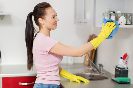 woman or housewife cleaning table at home kitchen Stock Photo