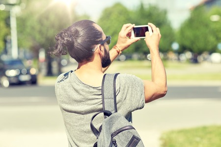 hipster man taking picture on smartphone Stock Photo