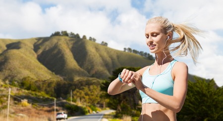 woman with fitness tracker doing sports outdoors