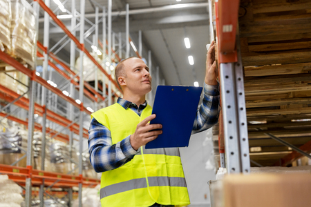 warehouse worker with clipboard in safety vest