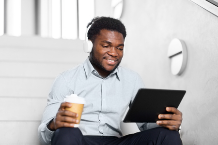 businessman with headphones and tablet pc