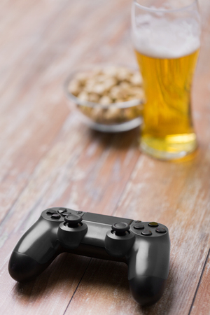 gaming, technology and entertainment concept - blue gamepad controller on table Stok Fotoğraf