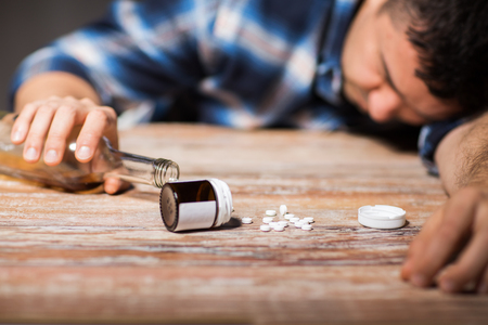 dead man overdosed on pills with alcohol Stock Photo