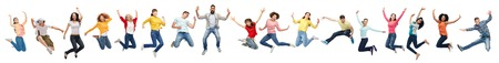 happy people jumping in air over white background Archivio Fotografico
