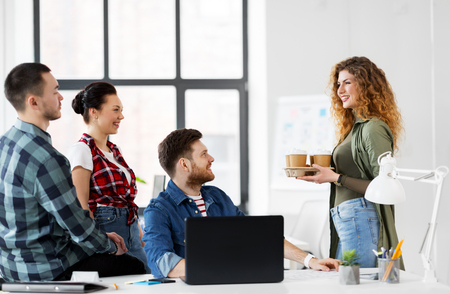 happy creative team with coffee working at office Stock Photo