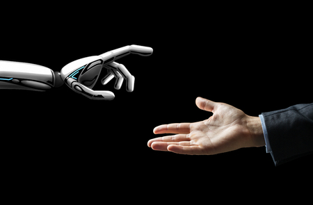 artificial intelligence, future technology and communication concept - robot and human hand over black background Stock Photo