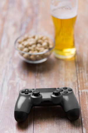 gaming, technology and entertainment concept - blue gamepad controller on table 写真素材