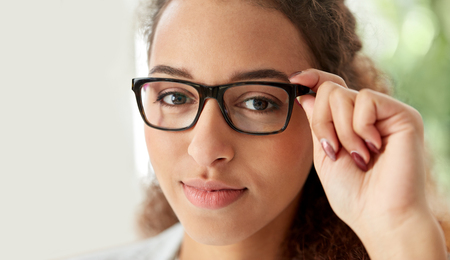 business, education and vision concept - portrait of african american woman in glasses at office