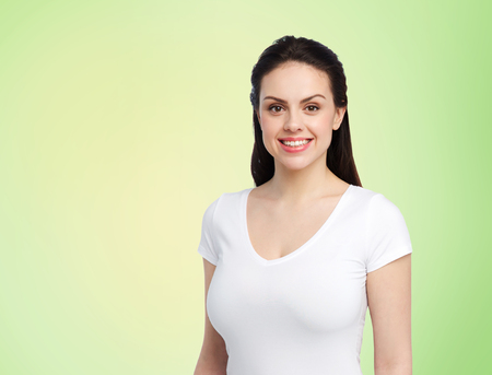 body positive and people concept - happy woman in white t-shirt over lime green background Stock Photo
