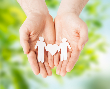 male hands holding paper gay couple pictogram