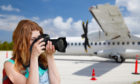 tourist woman photographing by camera over plane Banco de Imagens