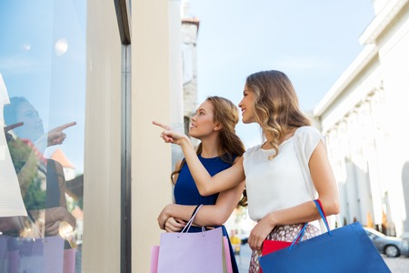 happy women with shopping bags at storefront Stockfoto - 102956325