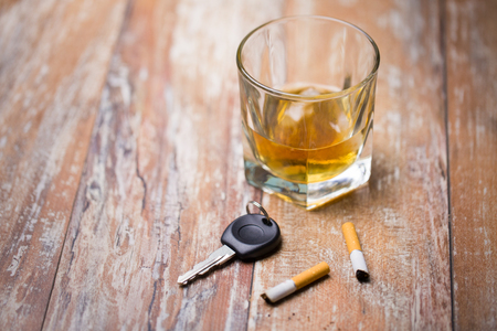 close up of alcohol and car key on table