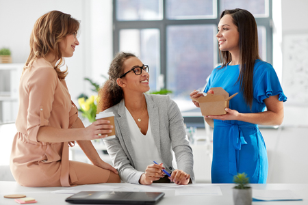 businesswomen having lunch at office Stock Photo