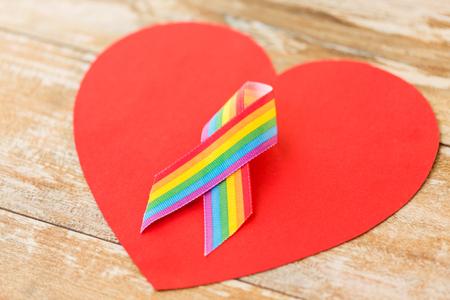 close up of gay pride awareness ribbon on heart Archivio Fotografico