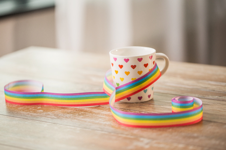 cup with heart pattern and gay awareness ribbon