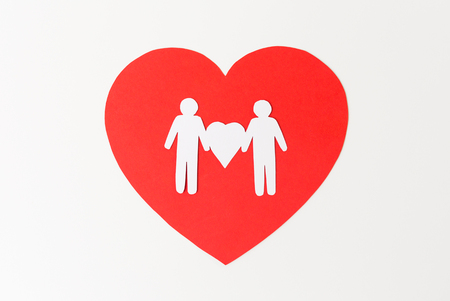 male couple white paper pictogram on red heart