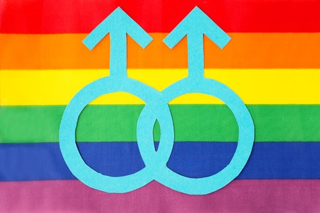 gay pride, homosexual and lgbt concept - male gender symbol on rainbow flag background