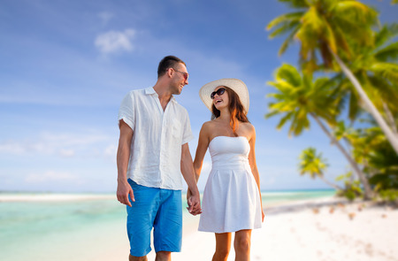 happy couple on vacation over tropical beach