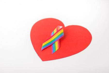 gay pride awareness ribbon on red heart Archivio Fotografico