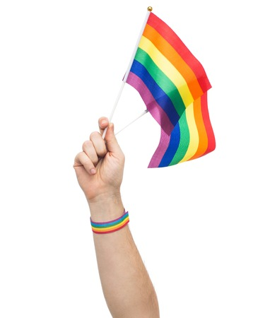 hand with pride rainbow flags and wristband