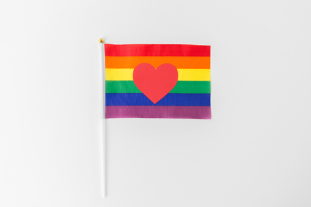 red heart on rainbow flag over white background