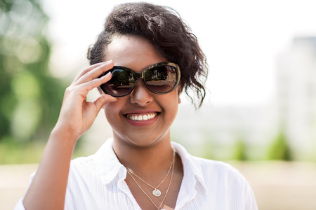 happy african american young woman in sunglasses Stock Photo