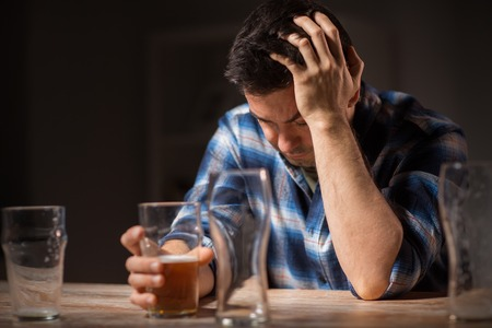 alcoholic drinking beer from glass at night Stock Photo