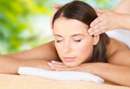 close up of beautiful woman having head massage Stock Photo