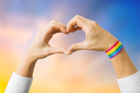 woman with gay awareness wristband showing heart