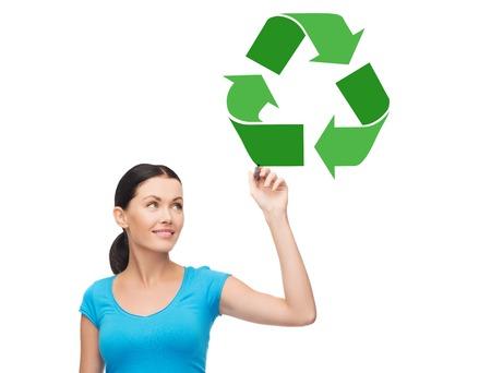 happy woman drawing green recycle symbol Archivio Fotografico - 104509688
