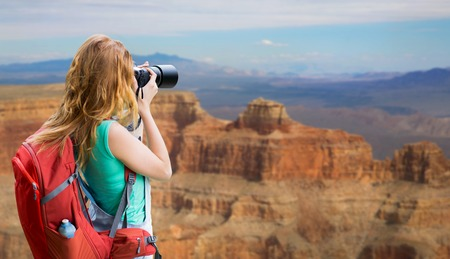 woman with backpack and camera at grand canyon Reklamní fotografie