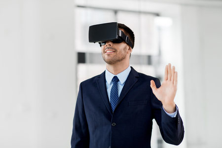 businessman with virtual reality headset at office Stock Photo