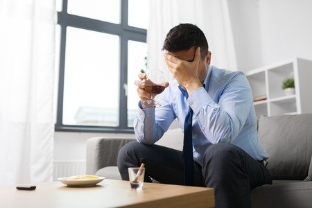 male alcoholic drinking alcohol at home Stock Photo - 104697063