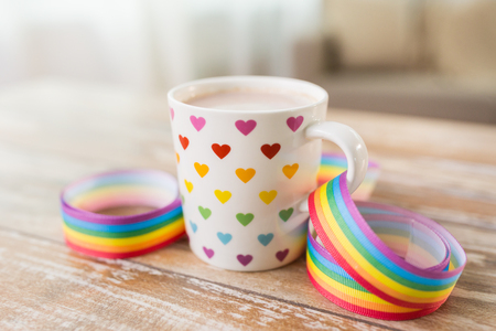cup with heart pattern and awareness ribbon