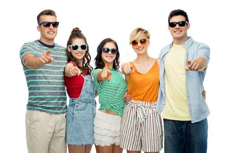 friendship, summer and people concept - group of happy smiling friends in sunglasses hugging over white background pointing at you