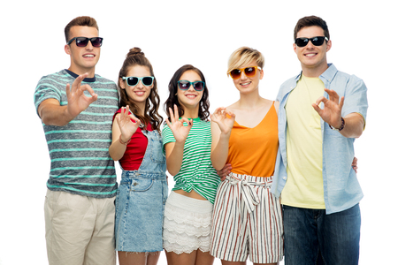 friends in sunglasses showing ok hand sign