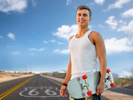 man with skateboard over us route 66 background