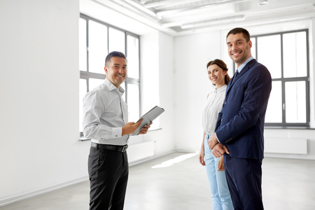 realtor with folder and customers at new office